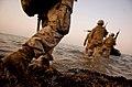 Flickr - DVIDSHUB - 8th Provisional Security Company Marines Board Zodiac.jpg