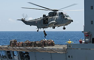 Royal Canadian Navy - A CH-124 Sea King lowers a crewman onto the deck of USNS ''Yukon'' during RIMPAC 2012.