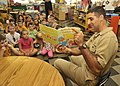 Flickr - Official U.S. Navy Imagery - Cmdr. Mark J. Colombo reads to children..jpg