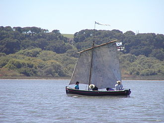 Yal (boat) -  Four-oared yal of Boat-Base Monterey sailing in Moss Landing, California, 2002