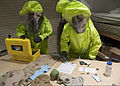 From left, U.S. Air Force Airmen 1st Class Eric Welsh and William Workman, both with the 376th Expeditionary Civil Engineer Squadron Emergency Management Flight, identify simulated hazardous substances during 130306-F-KZ210-002.jpg