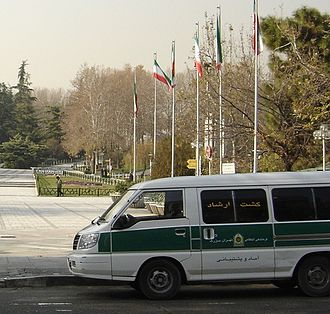 Islamic religious police - A Guidance Patrol Delica van parked in front of Mellat Park, Tehran