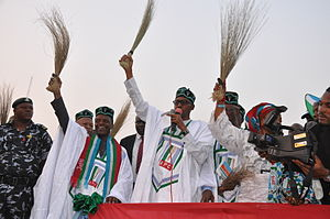 Nigerian general election, 2015 - General Muhammadu Buhari holding a broom at a campaign rally.