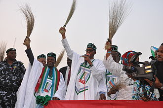 Broom - Nigerian opposition politicians holding brooms at a campaign rally