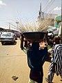 Girl hawking brooms at Oja Oba, Ilorin, Kwara State 05.jpg