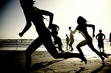Girls running on the beach (62902).jpg
