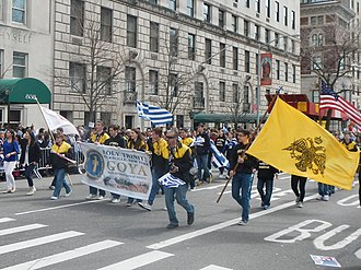 Greek Orthodox Archdiocese of America - The Greek Orthodox Youth Association of Hicksville, New York marching in a parade in New York.