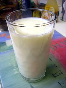 Glass of milk on tablecloth.jpg