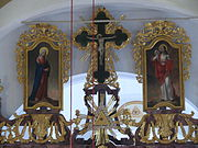 The three icons on the top of the iconostasis