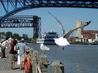 The Flats - The Goodtime III tour boat heads up the Cuyahoga River, as seen from the west bank of the Flats