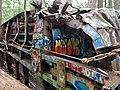 Graffiti on the train wreck (43493936921).jpg