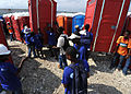 Haitian students assemble portable latrines in Port-au- Prince, Haiti, March 18, 2010 100318-N-HX866-003.jpg