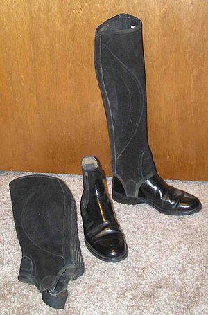 Riding boot - Half chaps worn over paddock boots duplicate the protection and visual line of a tall boot