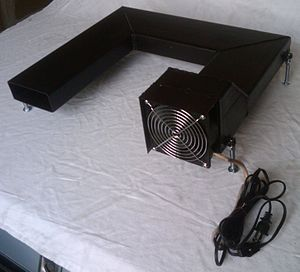Grate heater - This is a very basic tubular blower that sits under a grate and heats the air being pumped through it from the heat of the coals.  It has a high rate of airflow but a small surface area.