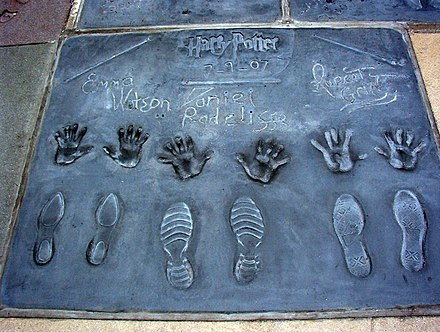 Handprints, shoe-prints and wand prints of (from left to right) Watson, Radcliffe, Grint, at TCL Chinese Theatre in 2007 Harry Potter cast.jpg