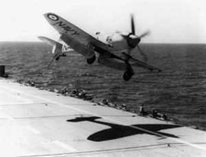 Hawker Sea Fury over HMAS Sydney (R17) 1956.jpg