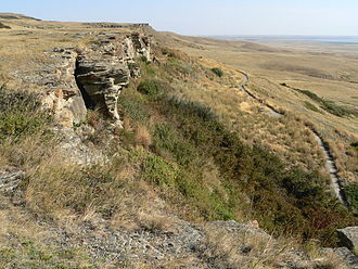 Rocky Mountain Foothills - A buffalo jump located where the foothills of the Rocky Mountains begin to rise from the prairie.