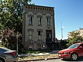 Henshie Briggs Row House Moved To 1614 Woodlawn DM Ia.jpg