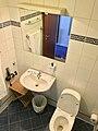 Hotel room toilet (bathroom) with hand wash sink, mirror, waste bin, toilet, etc., in Bergen, Norway 2018-03-16 C. Also wall and floor tiles.jpg