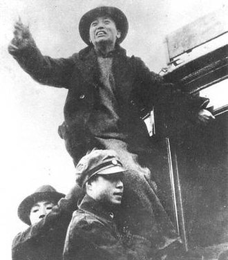 December 9th Movement - Student leader Huang Jing making a speech from a tram.