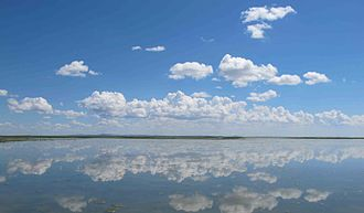Hulun Lake - Hulun Lake reflecting clouds and sky.