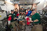 ISS-50 crew gathered together to celebrate the holidays in the Unity module.jpg