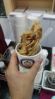 Ice cream topped with unusual sauce.jpg