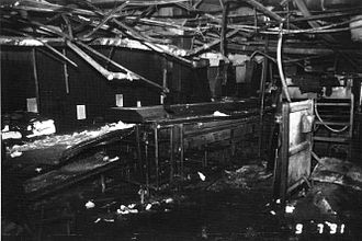 Hamlet chicken processing plant fire - The same cooker viewed from further back to give a better view of the general area. Note the heavy damage to the metal roof girders, testimony to the extreme heat of the fire.