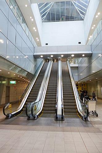 International Airport railway station, Sydney - Image: International Airport railway station Escalator to airport 2017