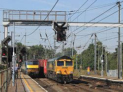 Ipswich - Greater Anglia 90012 and Freightliner 66572.jpg