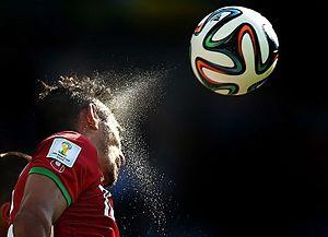 Adidas Brazuca - Iranian striker Reza Ghoochannejhad heading Adidas Brazuca in match against Argentina national football team