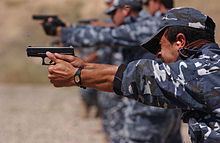 Soldiers target-shooting with handguns