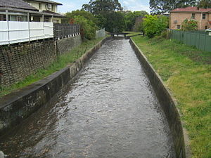 Iron Cove Creek - Iron Cove Creek flowing swiftly after a thunderstorm. Looking upstream from the Church Street bridge, Croydon, NSW