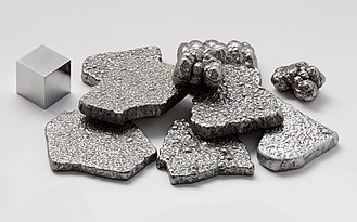 Metal - Iron, shown here as fragments and a 1 cm3 cube, is an example of a chemical element that is a metal