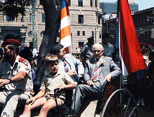 Jaap Marais - Jaap Marais arrives in a horse-drawn carriage at Church square, Pretoria. The two flags beside Marais are those of the former Boer republics of the Orange Free State (viewer's left) and Transvaal (viewer's right).