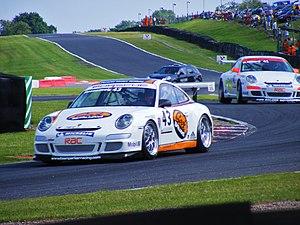Oulton Park - Jake Rosenzweig goes through Knickerbrook corner at Oulton Park during a Porsche Carrera Cup race.