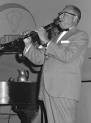 1963 in jazz - Joe Darensbourg playing clarinet with the Louis Armstrong combo at the Palais Royal in South Bend, IN, 1963