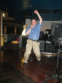 John Rennie Scientific American hits the karaoke mike.jpg
