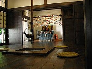 Irori - A jizaikagi hearth hook with fish-shaped counterbalance