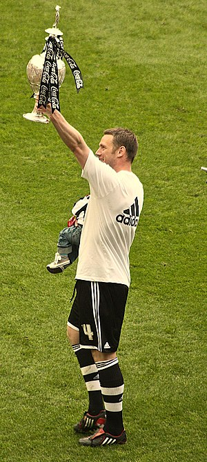 Kevin Nolan - Nolan holding the Championship trophy aloft in 2010