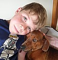 Kid with dachshund pet.jpg