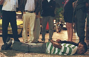 Kidnapping - Arrested kidnappers in Rio de Janeiro, Brazil lying on the ground