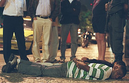Arrested kidnappers in Rio de Janeiro, Brazil lying on the ground Kidnappers arrested Rio.jpg