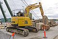 Komatsu PC228USLC-8 excavator with stone saw attachment at Barangaroo site open day.jpg