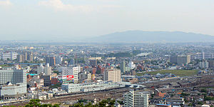 Kumamoto Station - Kumamoto Station viewed from Mount Hanaoka, June 2005