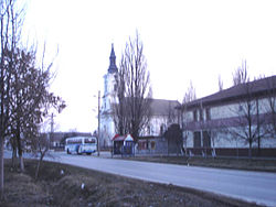 Kumane, main street and the Orthodox Church.jpg