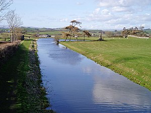 Lancaster Canal - The canal at Farleton, Cumbria, in the unnavigable northern section. The building on the left was used as stables for the packet boat services.