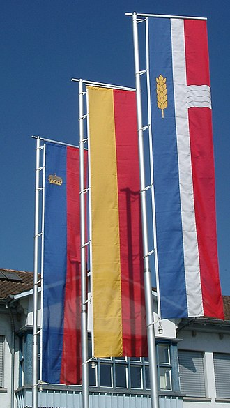 Flag of Liechtenstein - When flown vertically the crown on the flag is rotated so that it always faces upwards. (The flag on the left is that of Liechtenstein)