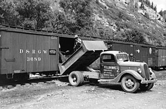 Denver and Rio Grande Western Railroad - Loading gold ore concentrate into freight cars, Ouray, Colorado, 1940