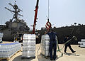 Loading bottled water on the USS McFaul (DDG 74).jpg